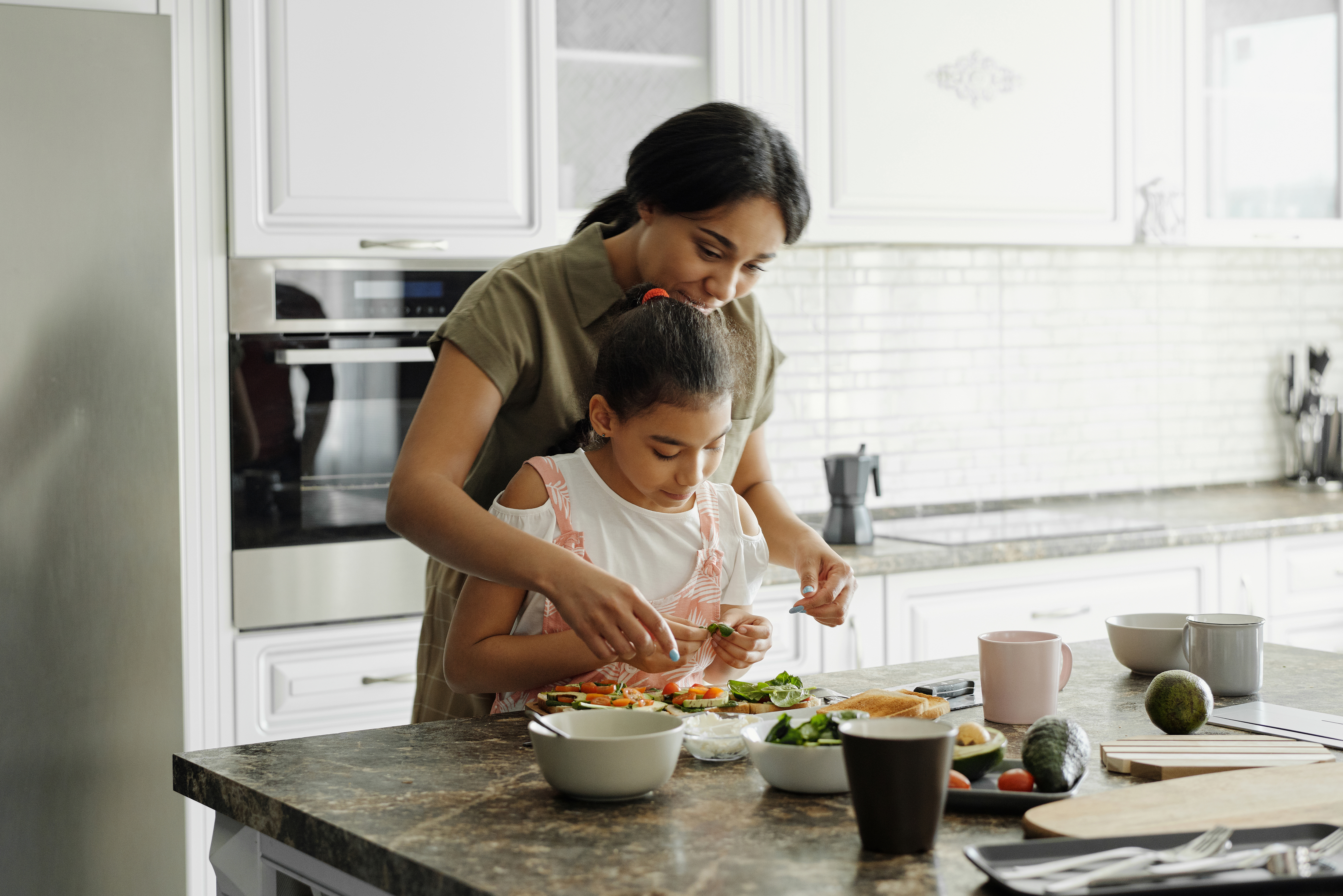 mother-and-daughter-preparing-avocado-toast-4259707-1
