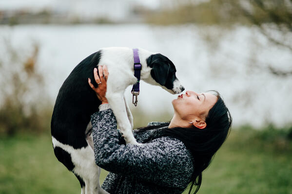 young-beautiful-woman-kissing-the-dog-outdoor